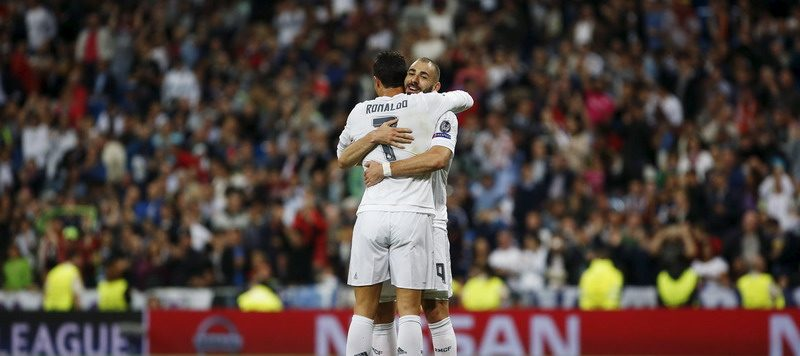 Real Madrid's Benzema celebrates scoring against Shakhtar Donetsk with team mate Ronaldo during their Champions League Group A soccer match at Santiago Bernabeu stadium in Madrid